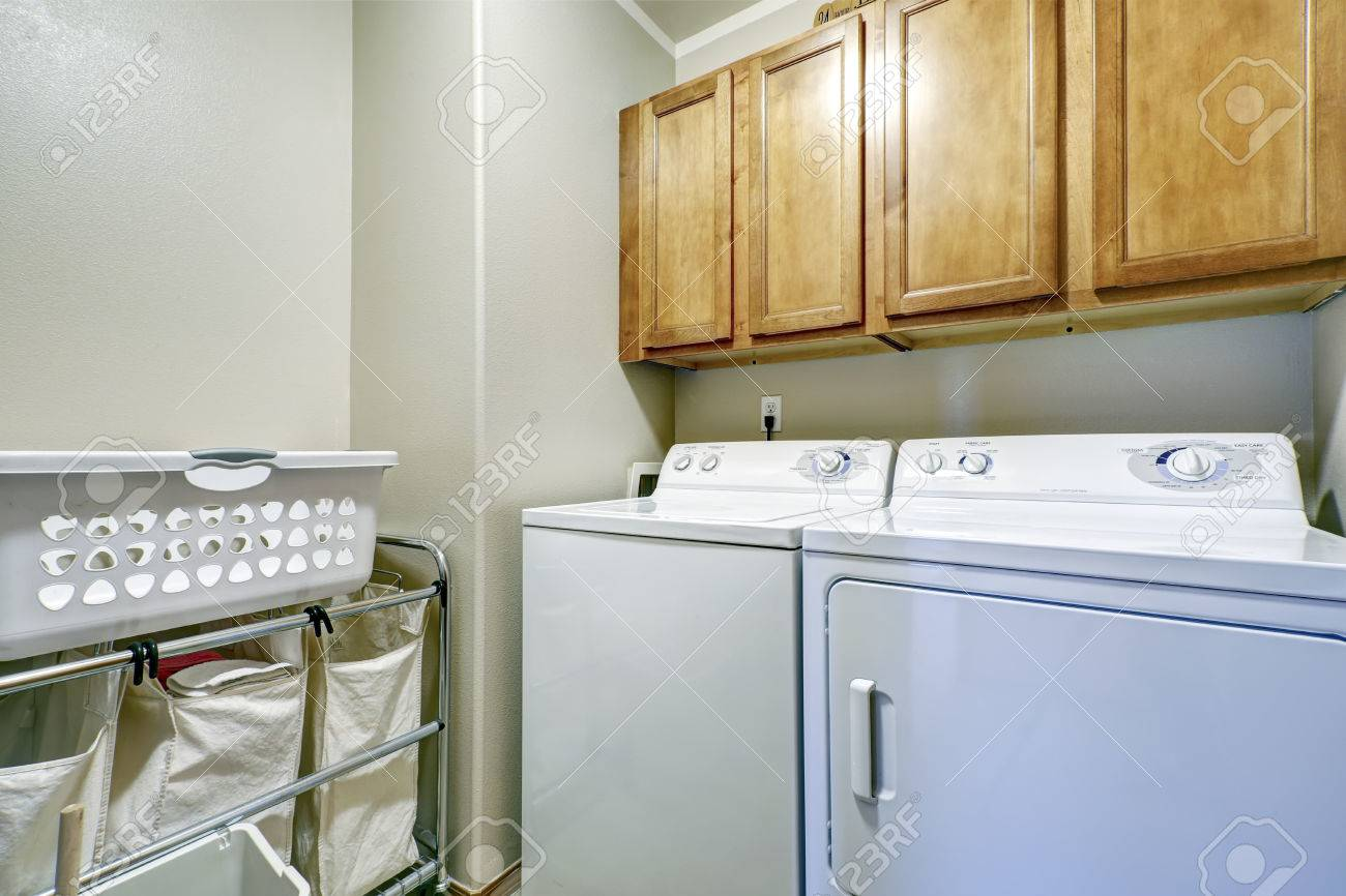 Laundry Room With Cloth Bags On Rack White Dryer And Washer