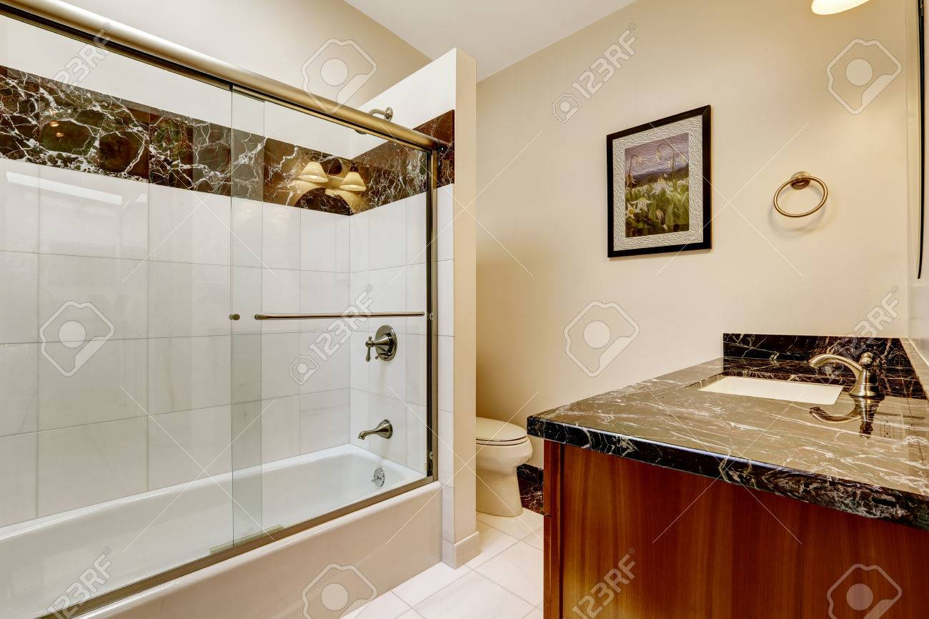 Bathroom With Glass Screened Bath Tub Brown Cabinet With Black Stock Photo Picture And Royalty Free Image Image 31999465
