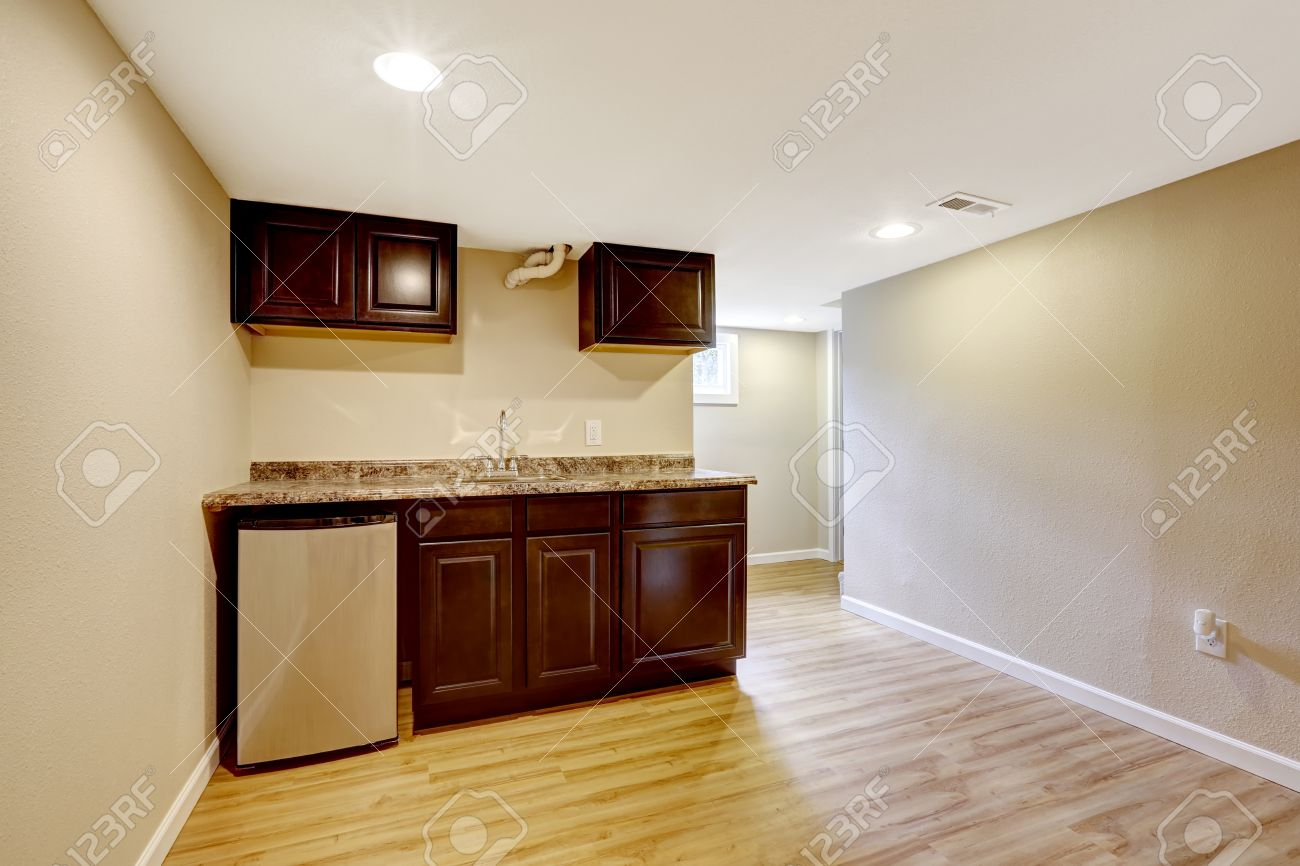 Empty Basement Room With Dark Brown Kitchen Cabinets Mother In Law Stock Photo Picture And Royalty Free Image 31999568