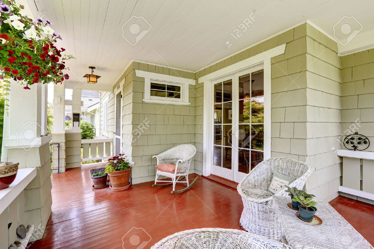 Decorating Old Houses Entrance Porch In Old House With Wicker Chairs And Glass Entrance