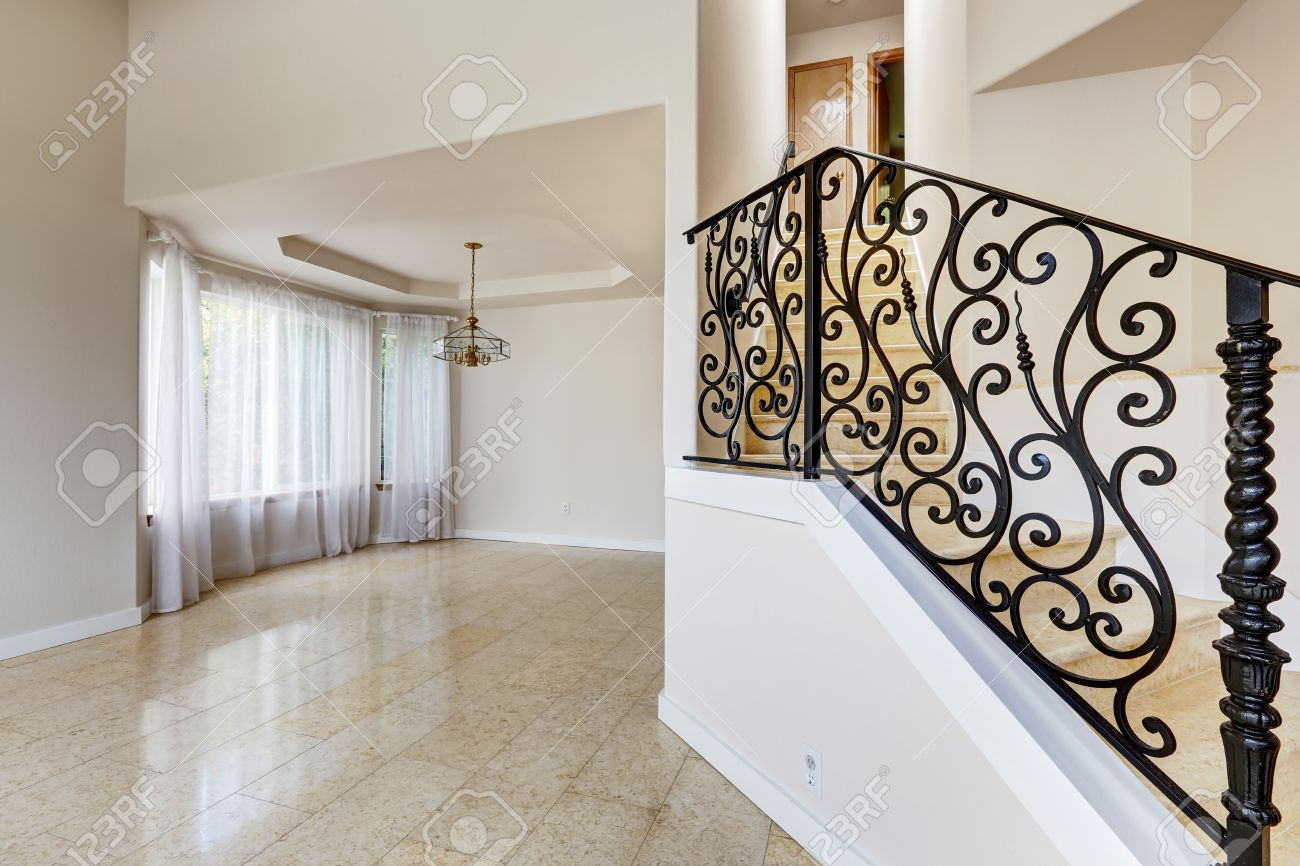 Emtpy house interior with shiny tile floor and brith white walls emtpy house interior with shiny tile floor and brith white walls marble staircase with black doublecrazyfo Image collections