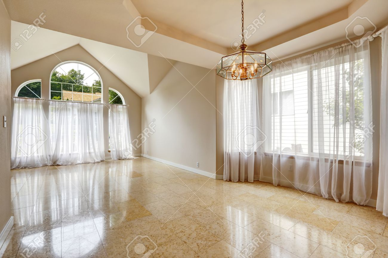 Emtpy house interior with shiny marble tile floor hight vaulted emtpy house interior with shiny marble tile floor hight vaulted ceiling with large windows and dailygadgetfo Images