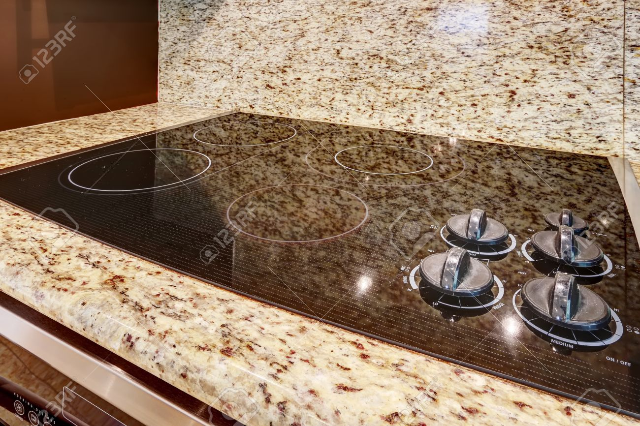 built in stove. Modern Built-in Stove With Shiny Black Flat Surface. Granite Counter Top. Stock Built In I