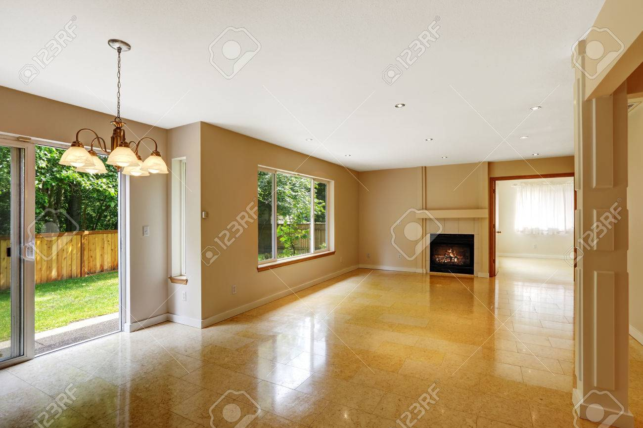 Empty Living Room With Shiny Marble Tile Floor And Fireplace ...