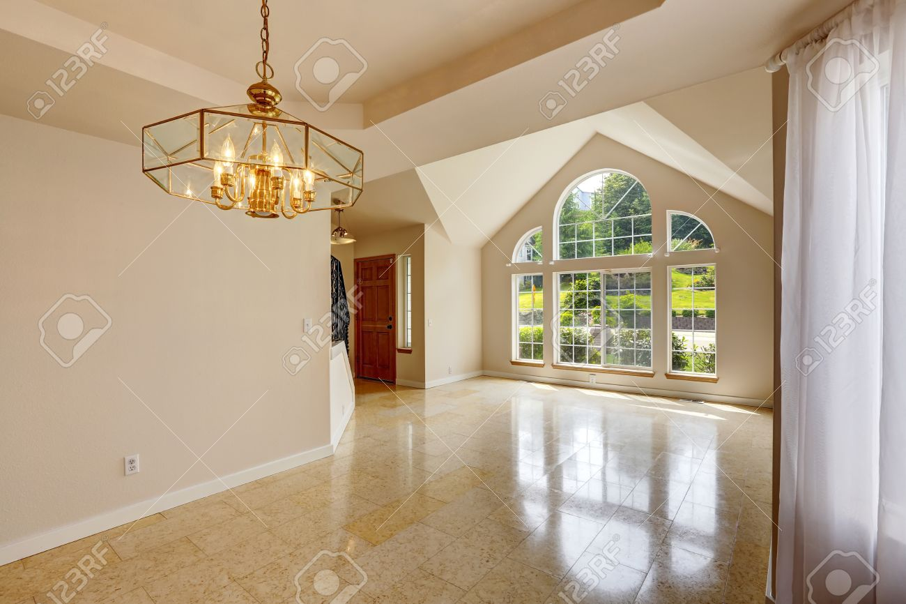 Emtpy house interior with shiny marble tile floor hight vaulted emtpy house interior with shiny marble tile floor hight vaulted ceiling with large windows stock dailygadgetfo Images