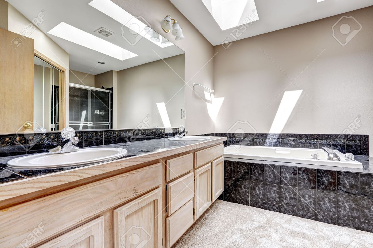 Bright Bathroom Interior With Carpet Floor White Bath Tub With Stock Photo Picture And Royalty Free Image Image 31999719