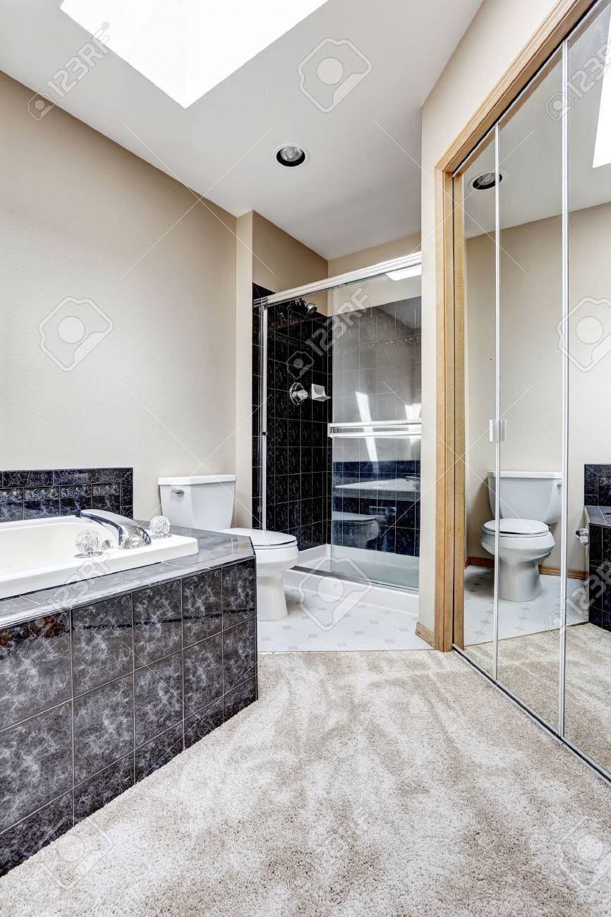 Bright Bathroom Interior With Carpet Floor, White Bath Tub With ...
