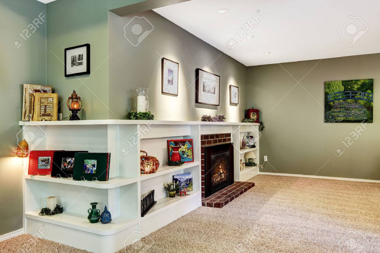 Light green and brown living room - Living Room In Light Green Color With Brown Soft Carpet Floor Fireplace With Derocated White