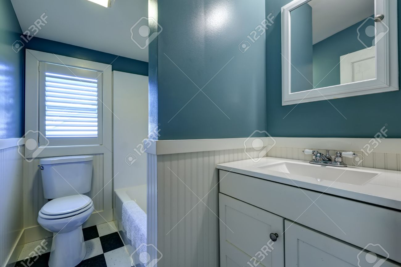 blue bathroom interior with white wall trim stock photo, picture