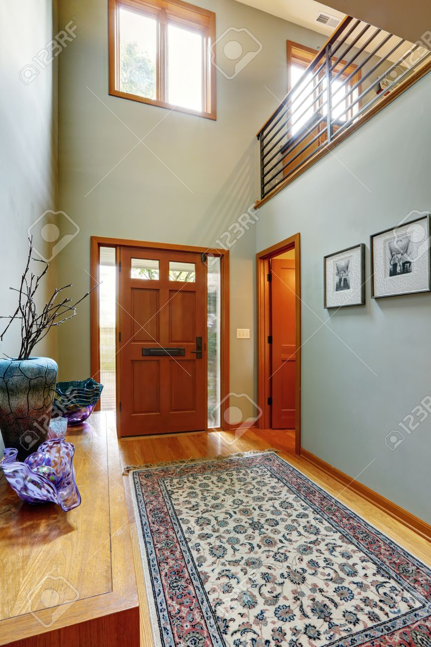 Entrance Hallway In Modern House With Aqua Tone Walls And High