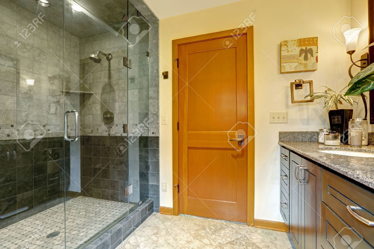 Modern bathroom interior with glass door shower and tile wall trim  Bathroom  with bright orange. Modern Bathroom Interior With Glass Door Shower And Tile Wall