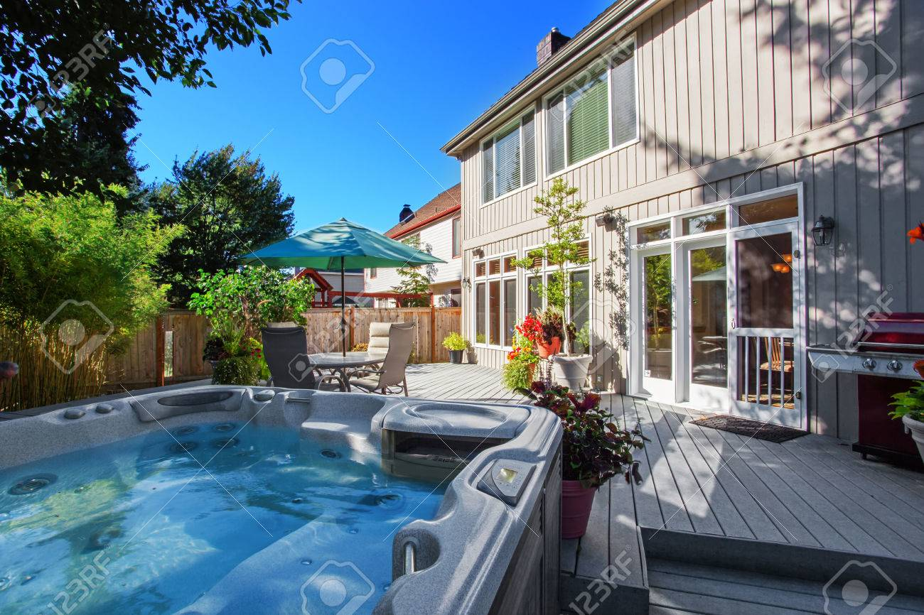 cozy backyard with patio area and jacuzzi walkout deck with