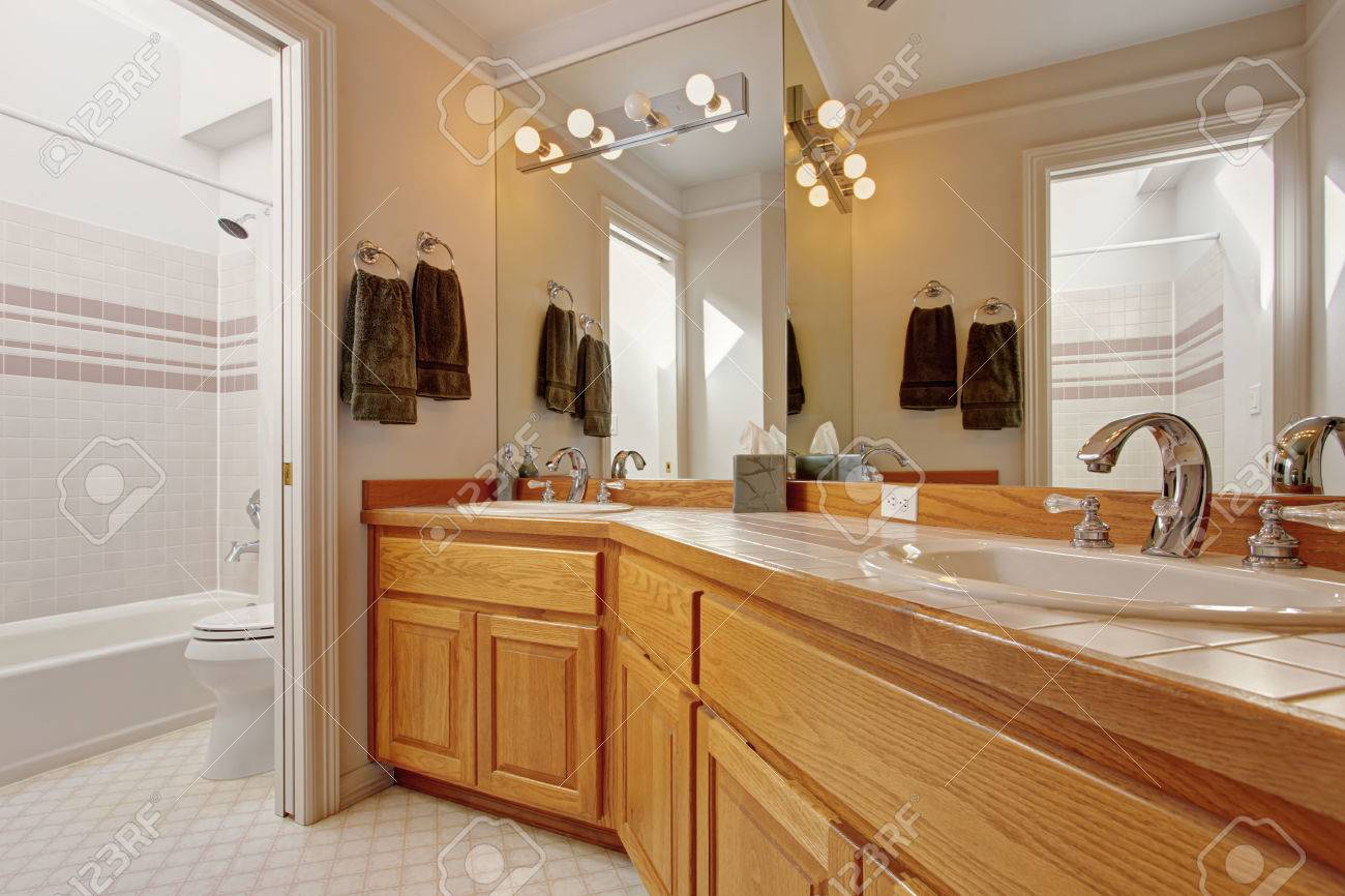 Wooden Bathroom Vanity Cabinet With Two Sinks And Large Mirror Stock Photo Picture And Royalty Free Image Image 32370446