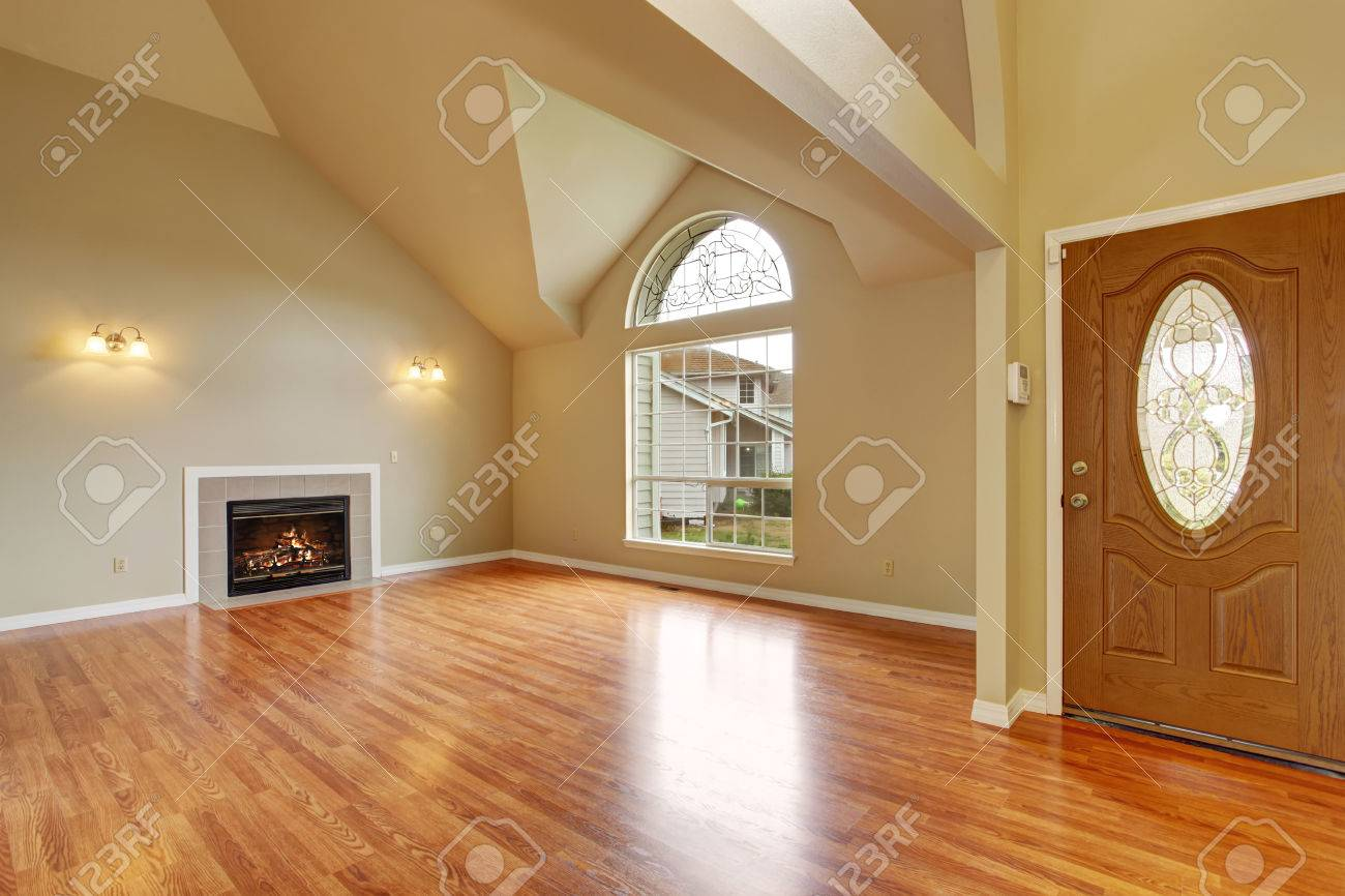Big empty living room - Spacious Living Room With High Ceiling Big Arch Window Fireplace And New Hardwood Floor