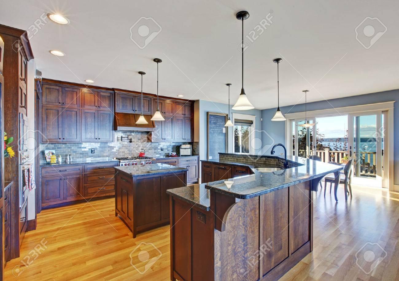 Luxury Kitchen With Dark Brown Storage Combination, Small Kitchen Island  And Tile Back Splash Trim