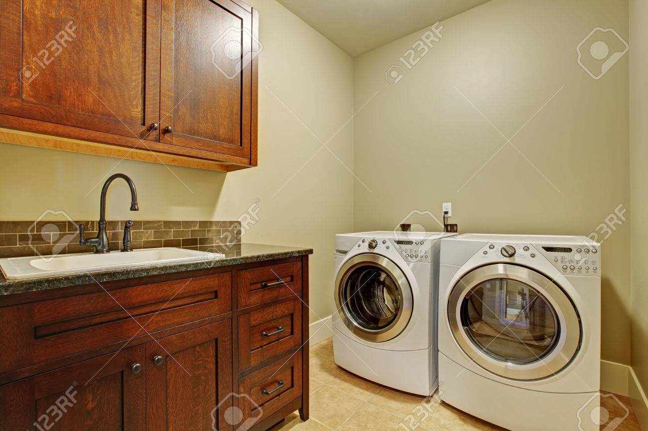Laundry Room With Modern Appliances Dark Brown Vanity Cabinet Stock Photo Picture And Royalty Free Image Image 32441770