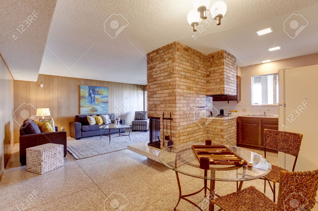 Basement Open Floor Plan Living Room With Dining And Kitchen Area Separated Brick Fireplace