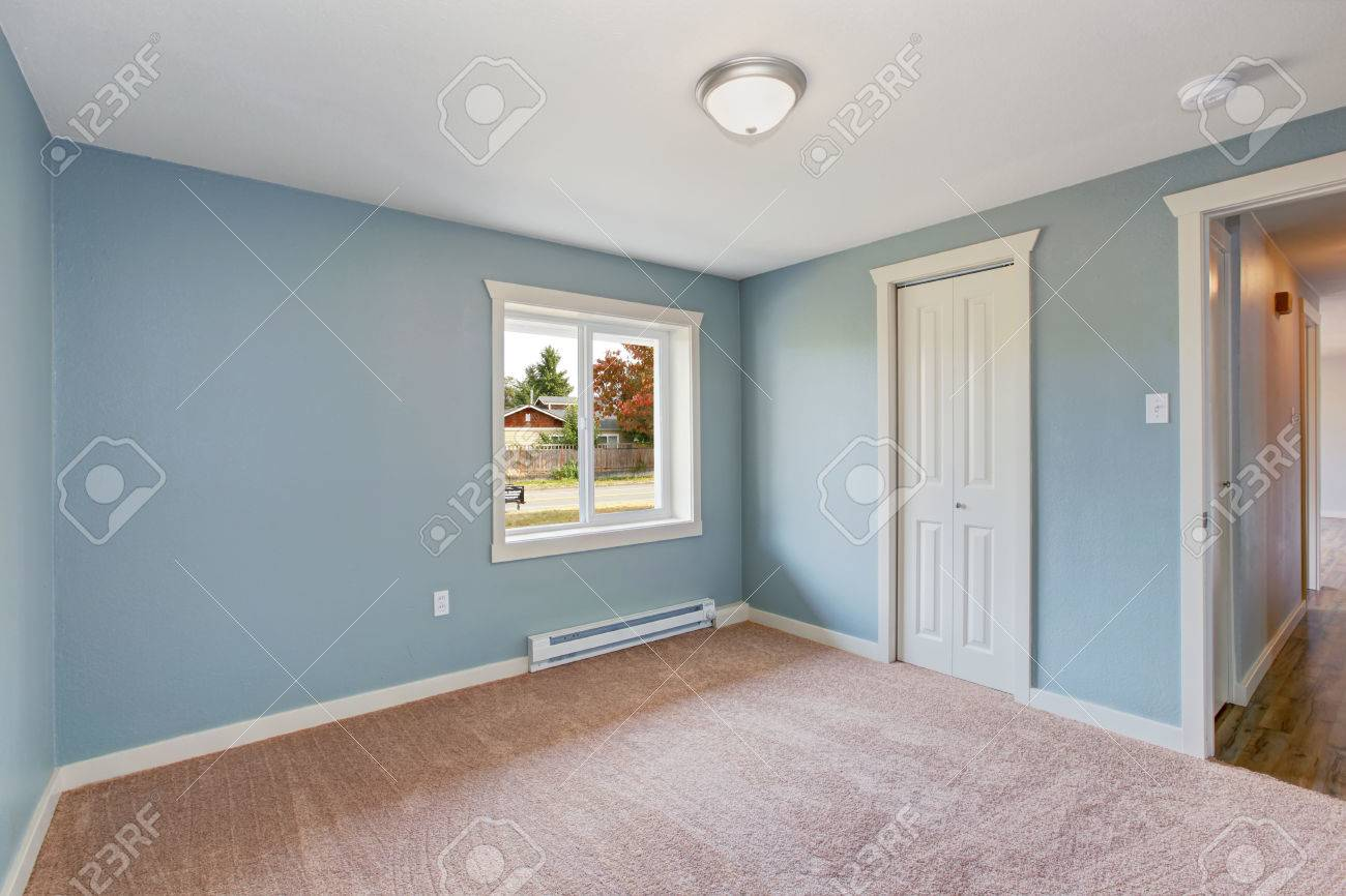 Empty Small Room With Light Blue Walls And Brown Carpet Floor Stock Photo Picture And Royalty Free Image Image 32559841