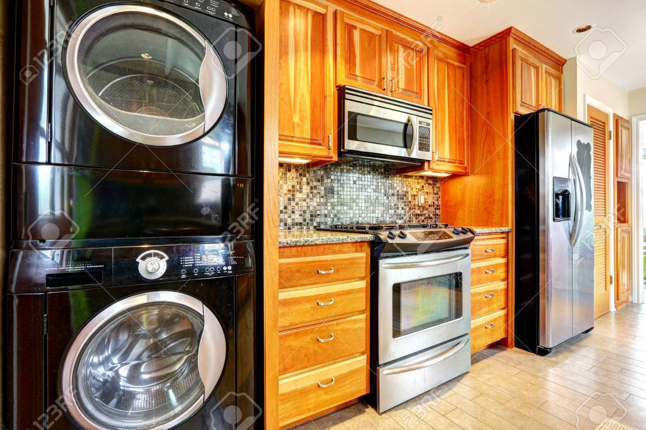 ordinary Combination Kitchen Appliances #8: Kitchen maple storage combination with steel kitchen appliances and black  laundry appliances Stock Photo - 32696451