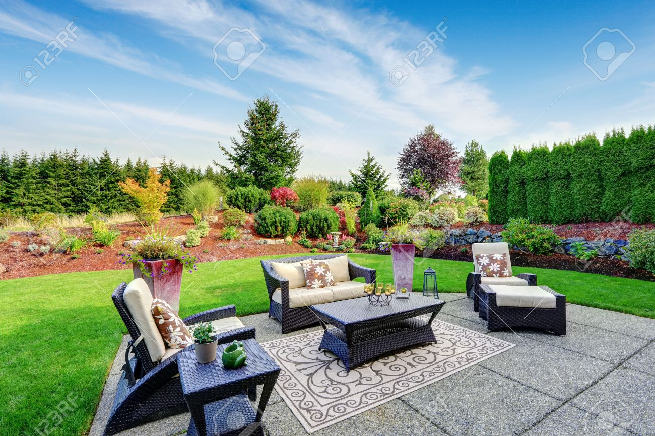 impressive backyard landscape design. cozy patio area with settees ... - Design A Patio Area
