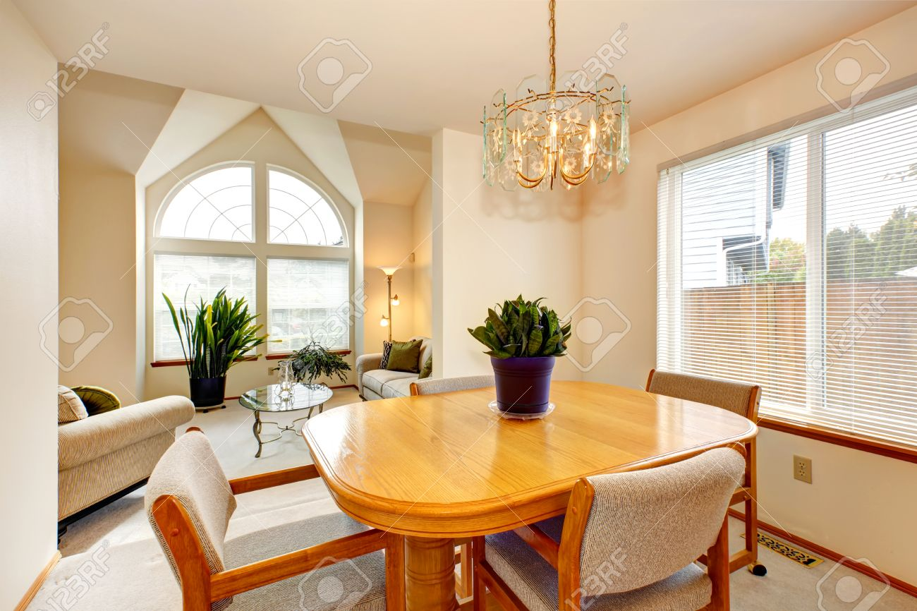 Bright Dining Area With Maple Dining Table Set And Living Room ...