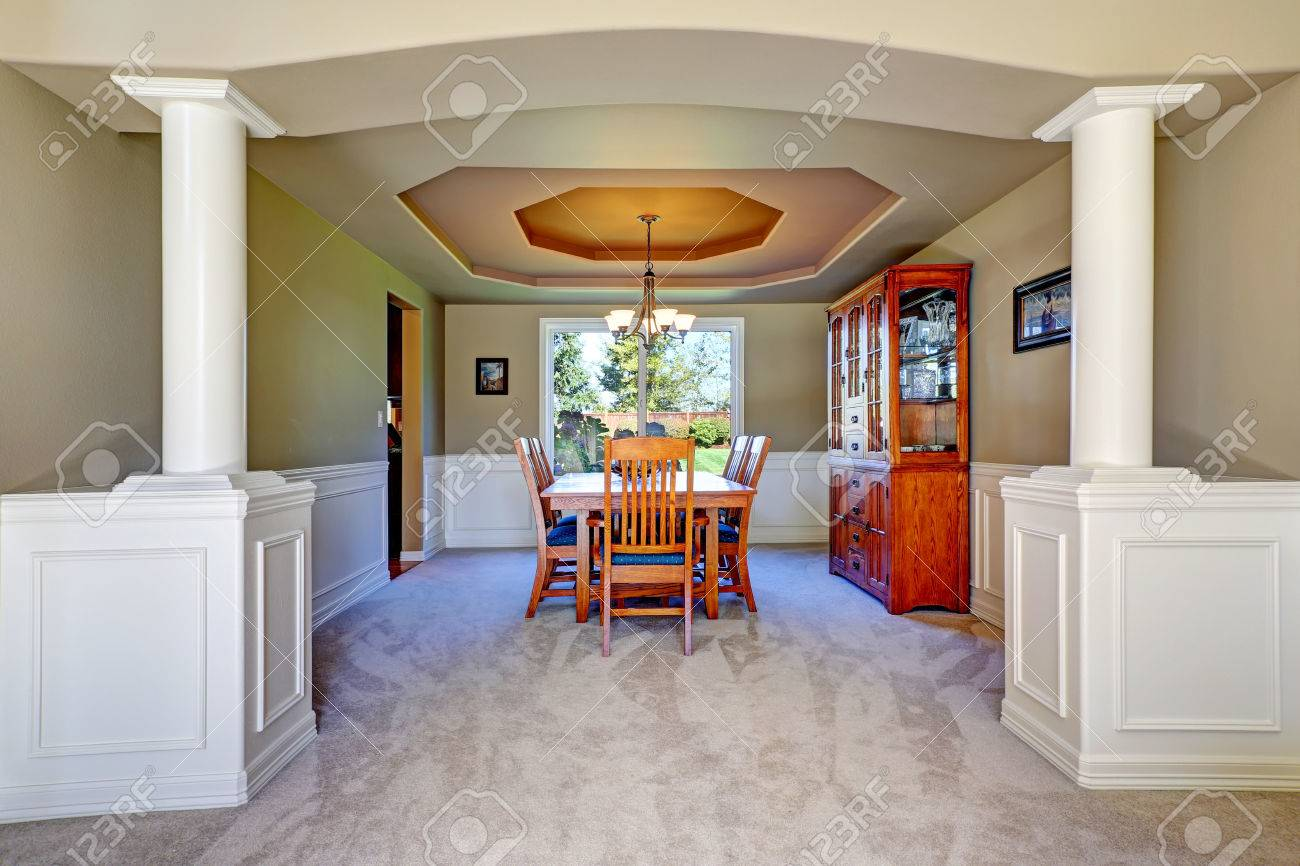 Luxury dining room with white columns and olive walls  Coffered ceiling and  carpet floor Stock. Luxury Dining Room With White Columns And Olive Walls  Coffered