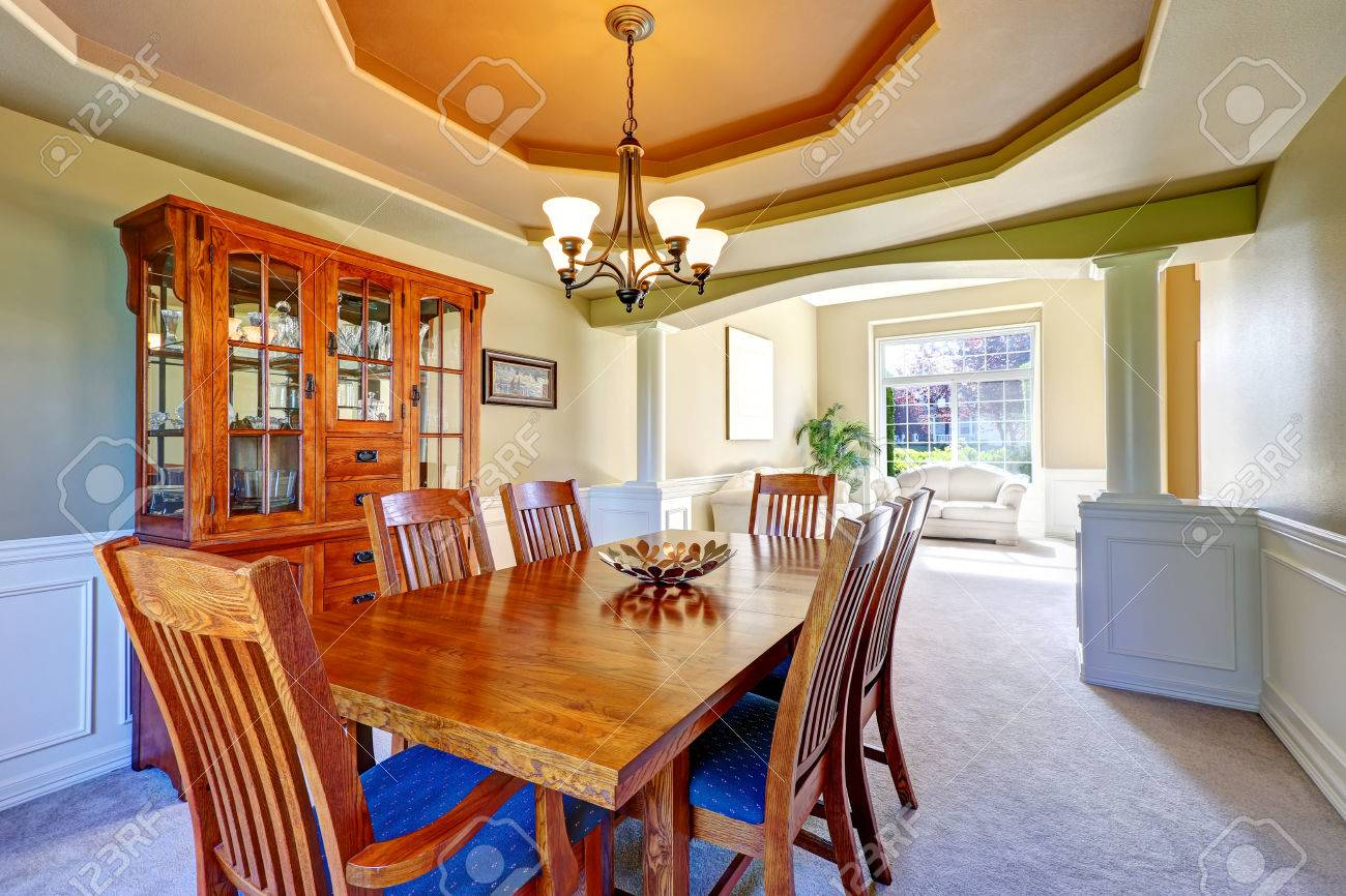 luxury dining room with white columns and olive walls coffered luxury dining room with white columns and olive walls coffered ceiling and carpet floor stock