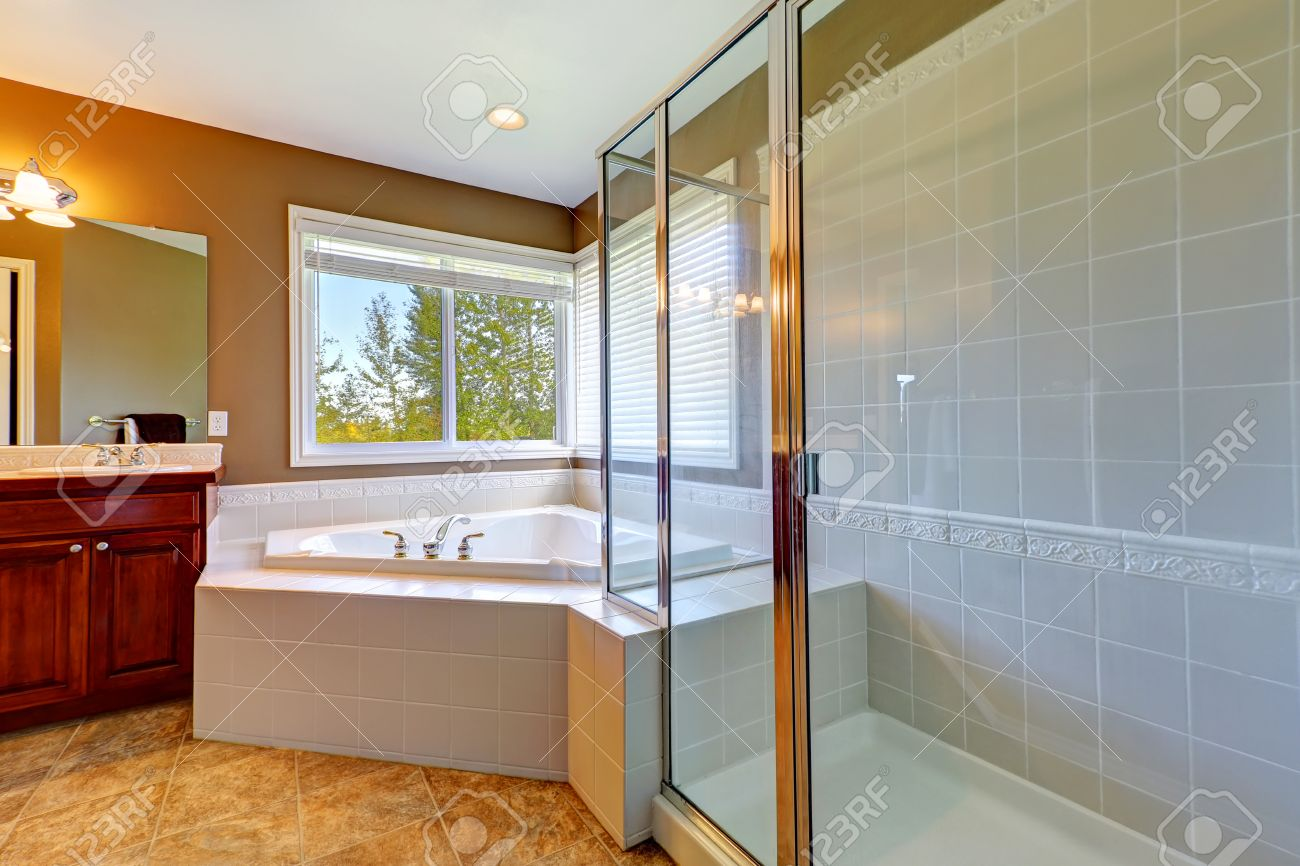 bathroom interior with corner bath tub and screened shower tile bathroom interior with corner bath tub and screened shower tile floor and white tile wall