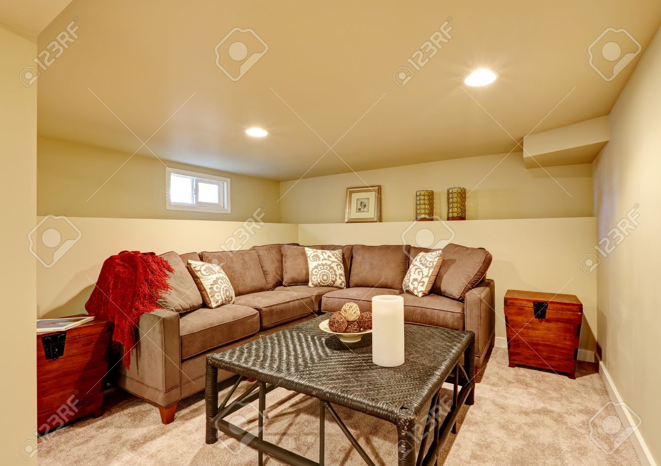 Comfortable Sofas For Family Room Part - 37: Cozy Family Room With Brown Comfortable Sofa And Wicker Table. Room With  Light Ivory Walls