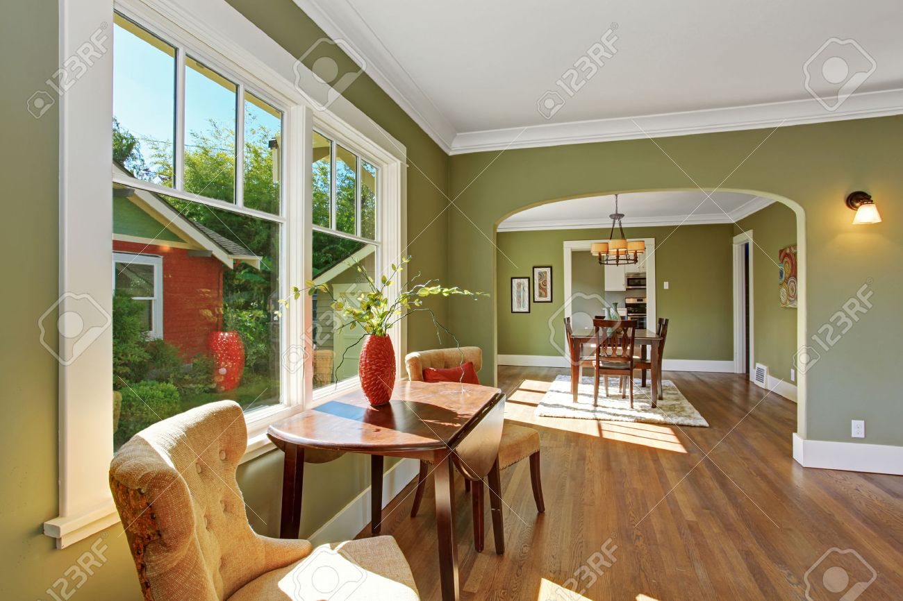 ... Dining Room With Archway. House Interior With Open Floor Plan. Sitting  Area By The Window With Table And Chairs Part 39