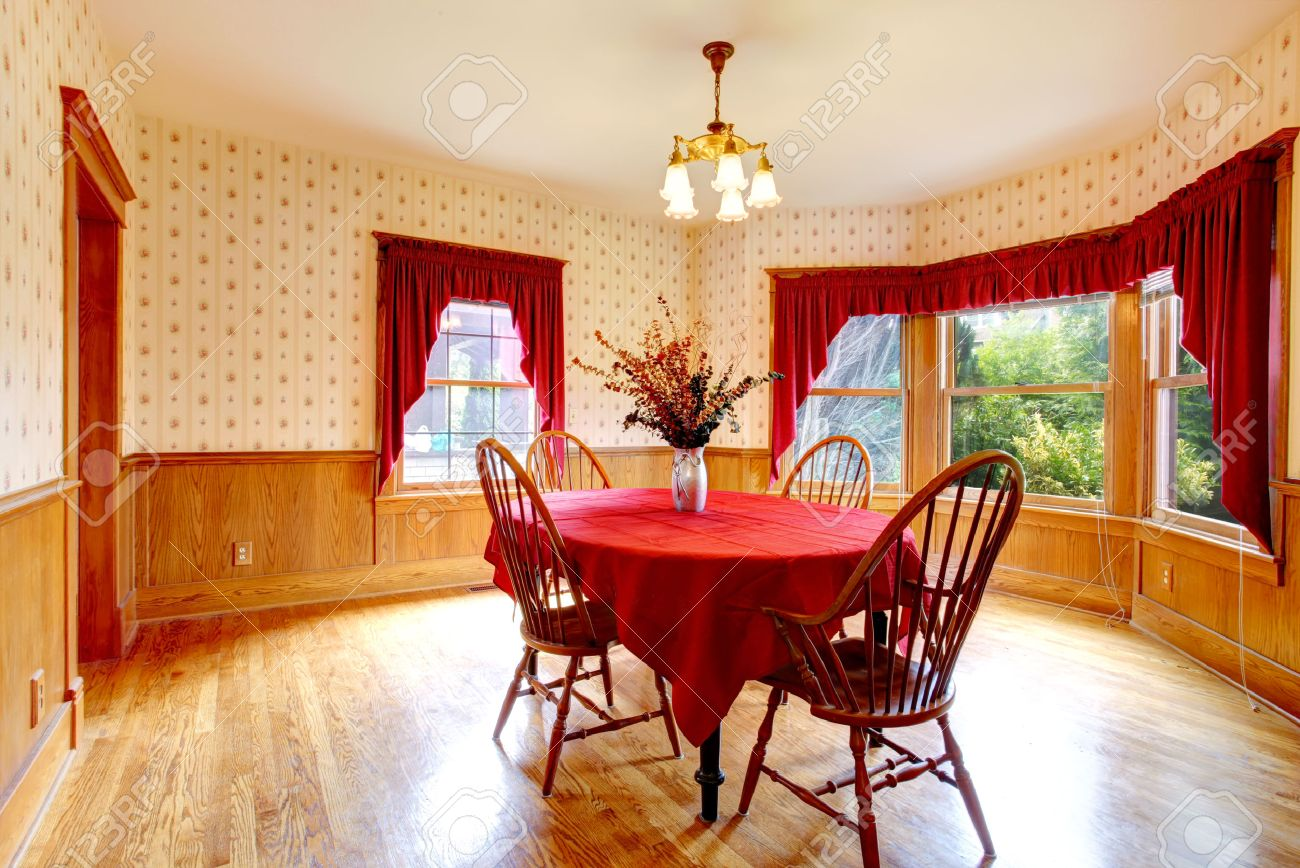 Old House Interior With Wooden Wall Trim And Wallpaper Dining Table Bright Red