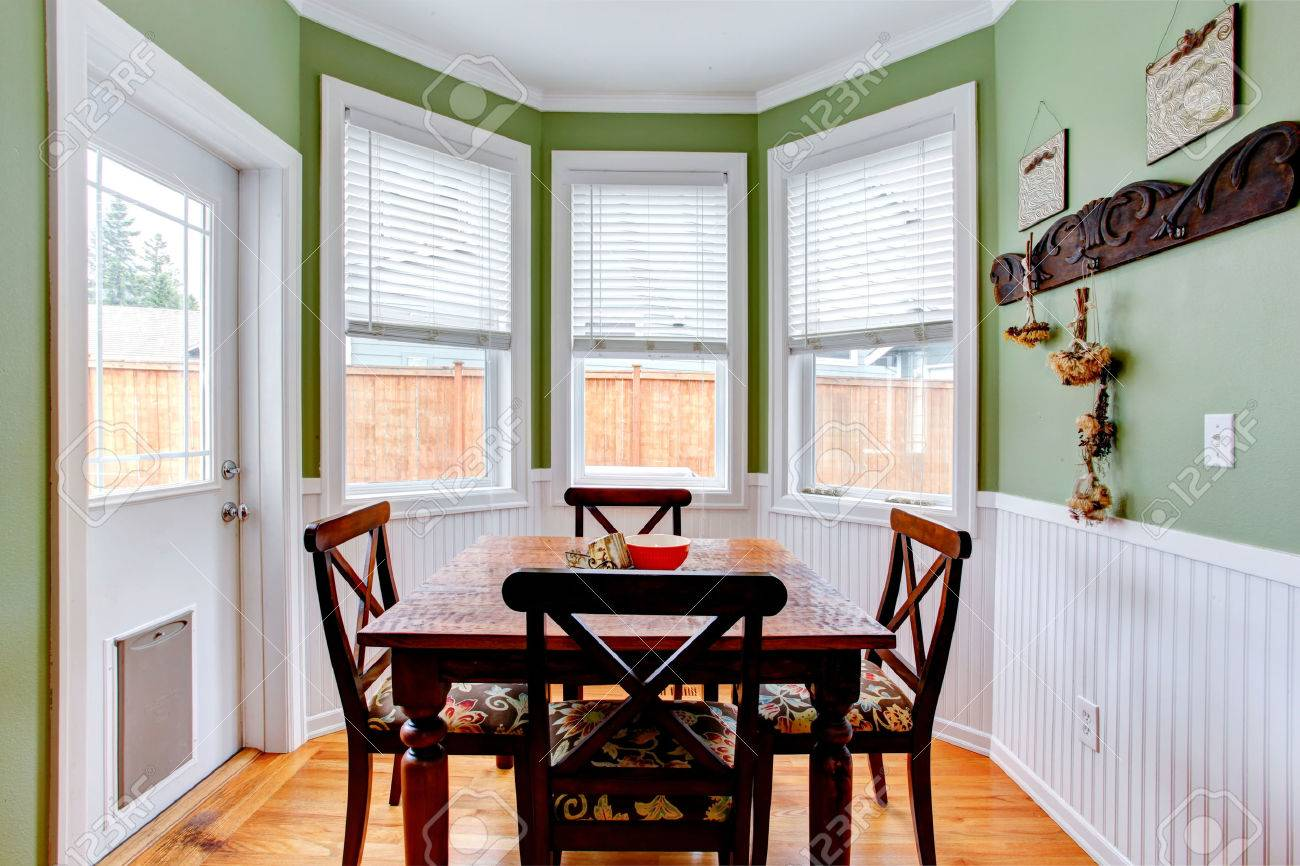 Dining Room In Light Mint Color With White Trim Table Set Has