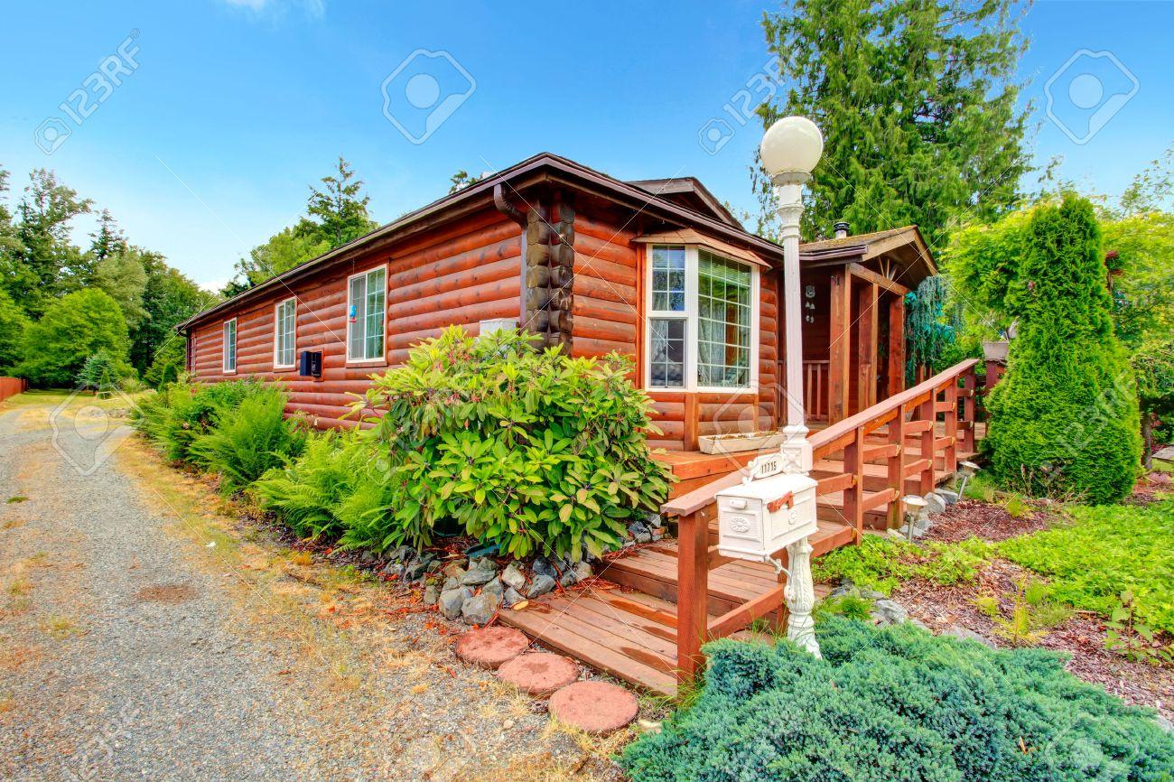 entrar estilo cabina exterior de la casa con encanto casa de madera con cubierta de