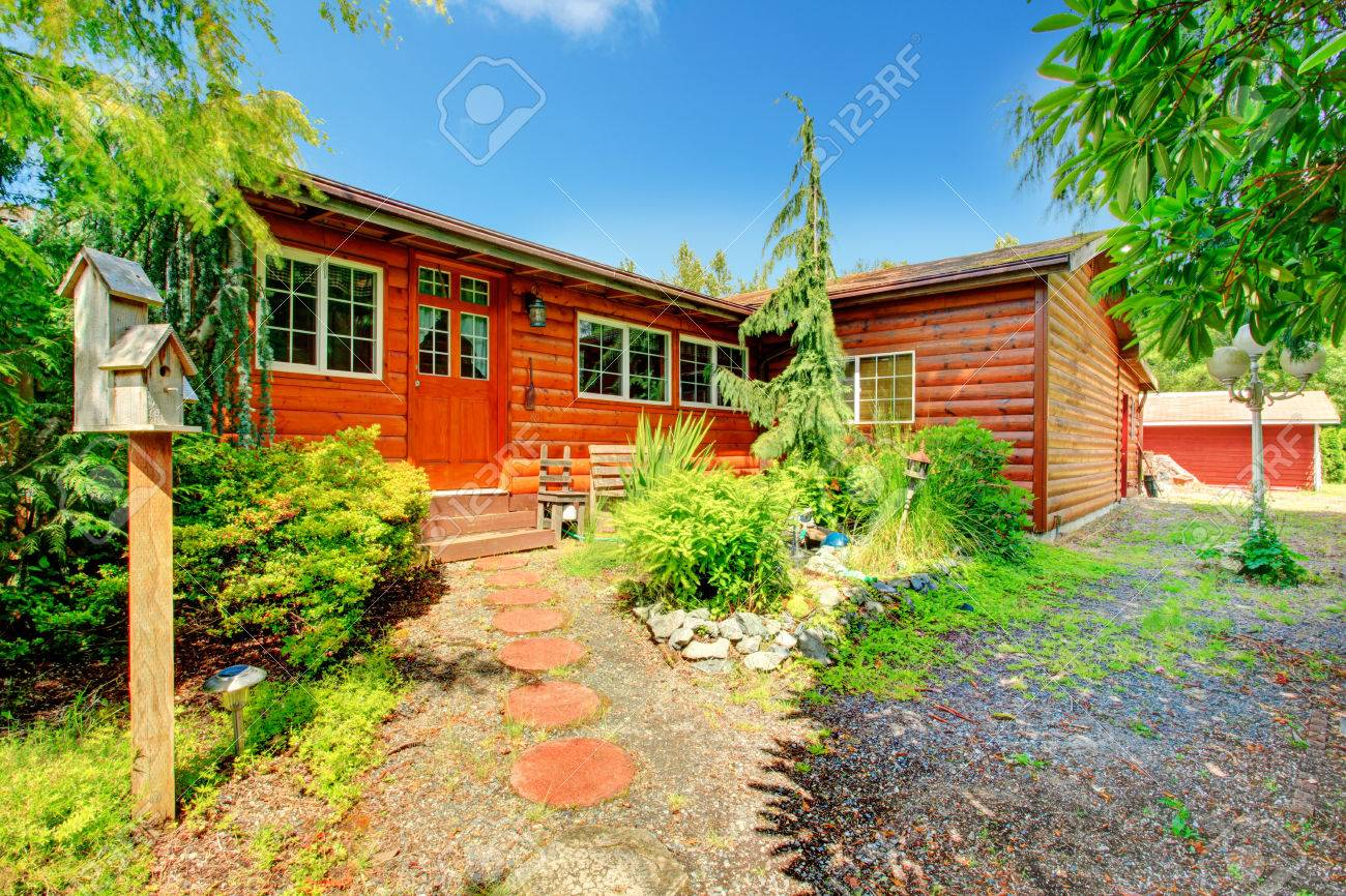 Cozy Log Cabin Style House Exterior With Curb Appeal Stock Photo