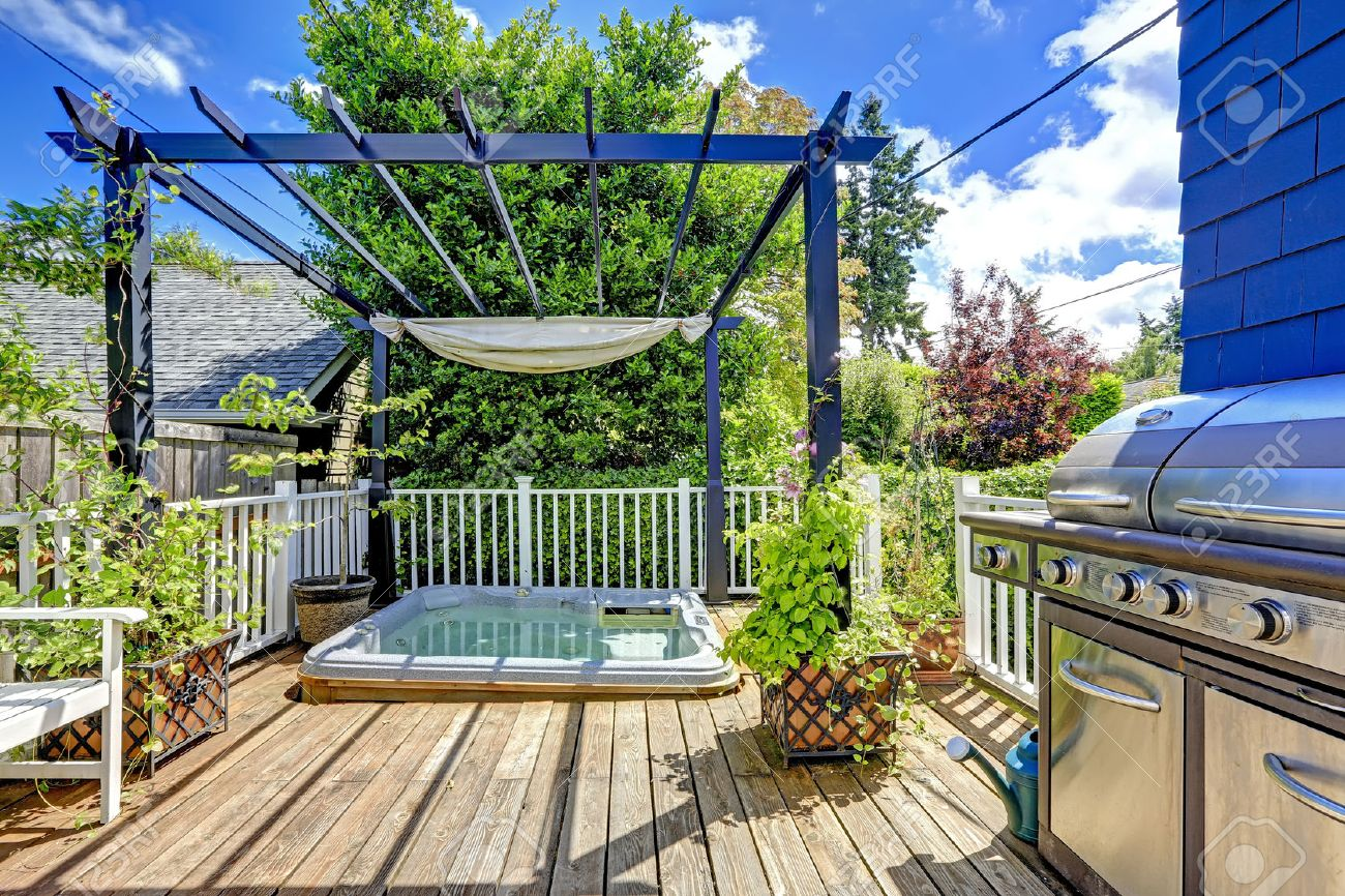 Walkout Deck With Jacuzzi And Pergola. Patio Area With Barbecue Stock Photo    34354302