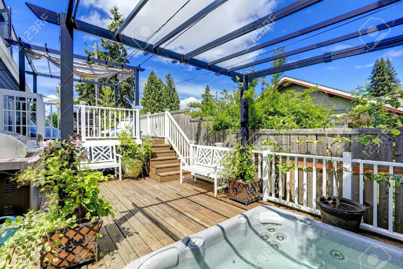 Stock Photo   Walkout Deck With Jacuzzi And Pergola. Patio Area With  Barbecue