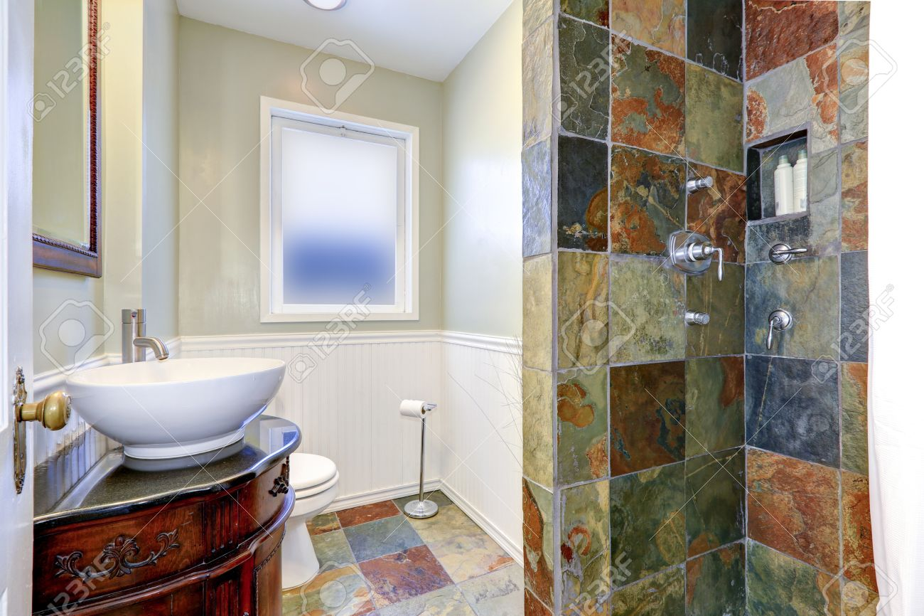 Bathroom Interior. Shower With Tile Wall Trim, Carved Wood Cabinet ...