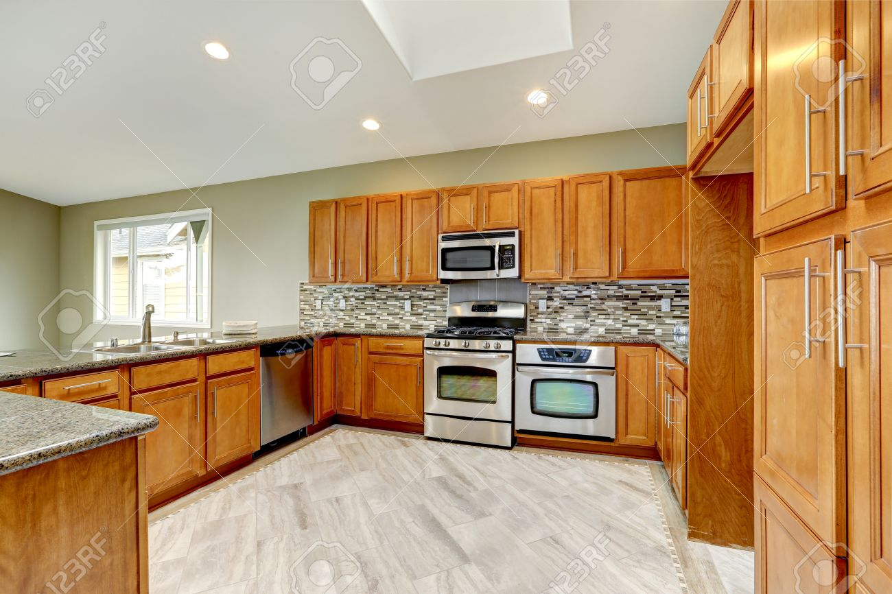 Luxury Kitchen Room With Bright Brown Cabinets Mosaic Backsplash Stock Photo Picture And Royalty Free Image Image 34340522