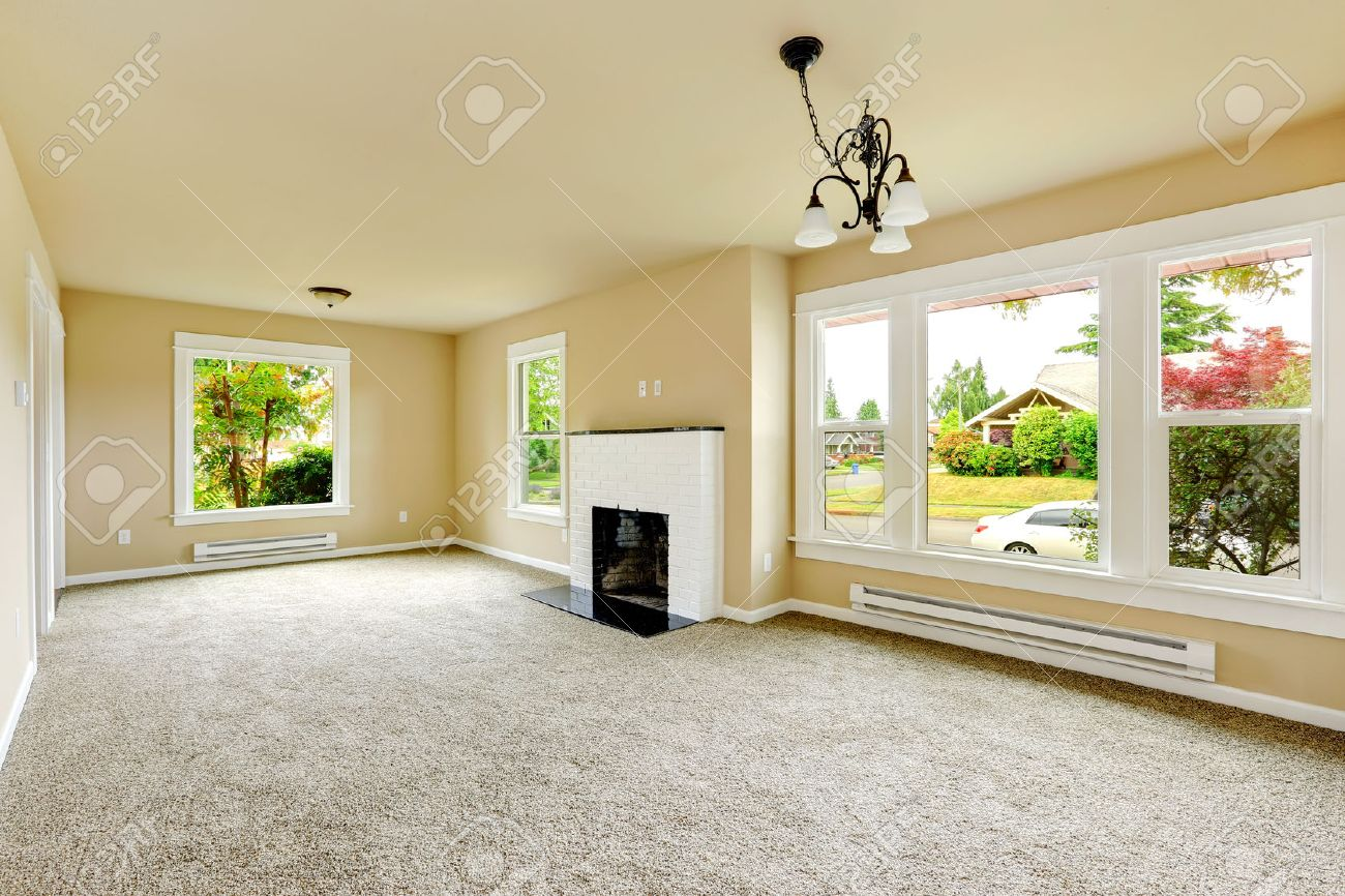 Emtpy House Interior. Family Room With Ivory Walls And Light.. Stock ...