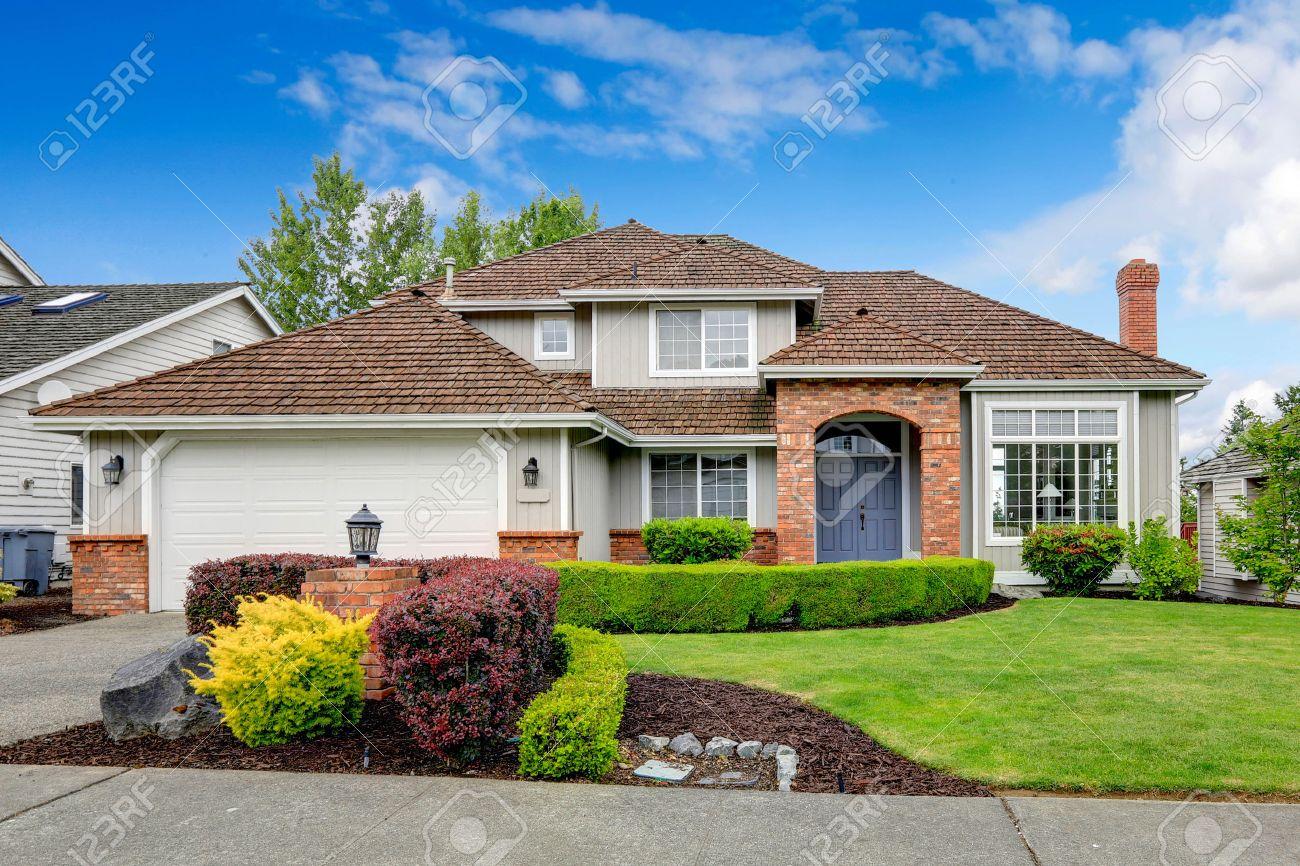 Garage Bilder house exterior with brick trimmed entrance porch green lawn