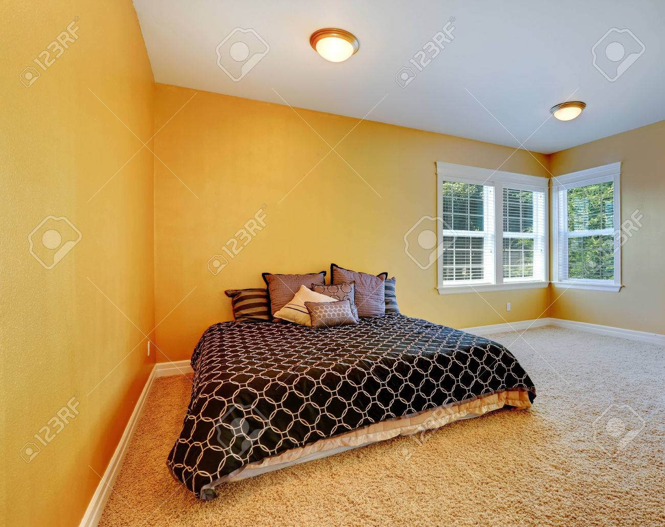 empty bedroom inteiror with queen size bed room in bright yellow color with beige soft - Soft Carpet For Bedrooms
