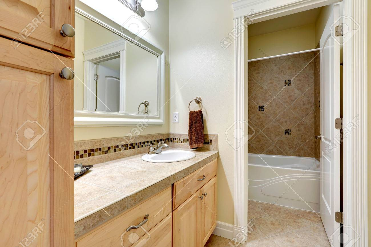 Light tones bahtroom vanity cabinet with tile counter top mirror light tones bahtroom vanity cabinet with tile counter top mirror bathroom with tile floor dailygadgetfo Choice Image