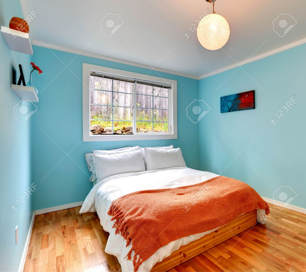 Light orange and white bedroom - Cozy Bedroom In Light Blue Color With Hardwood Floor And Wooden Single Bed With White Andcozy