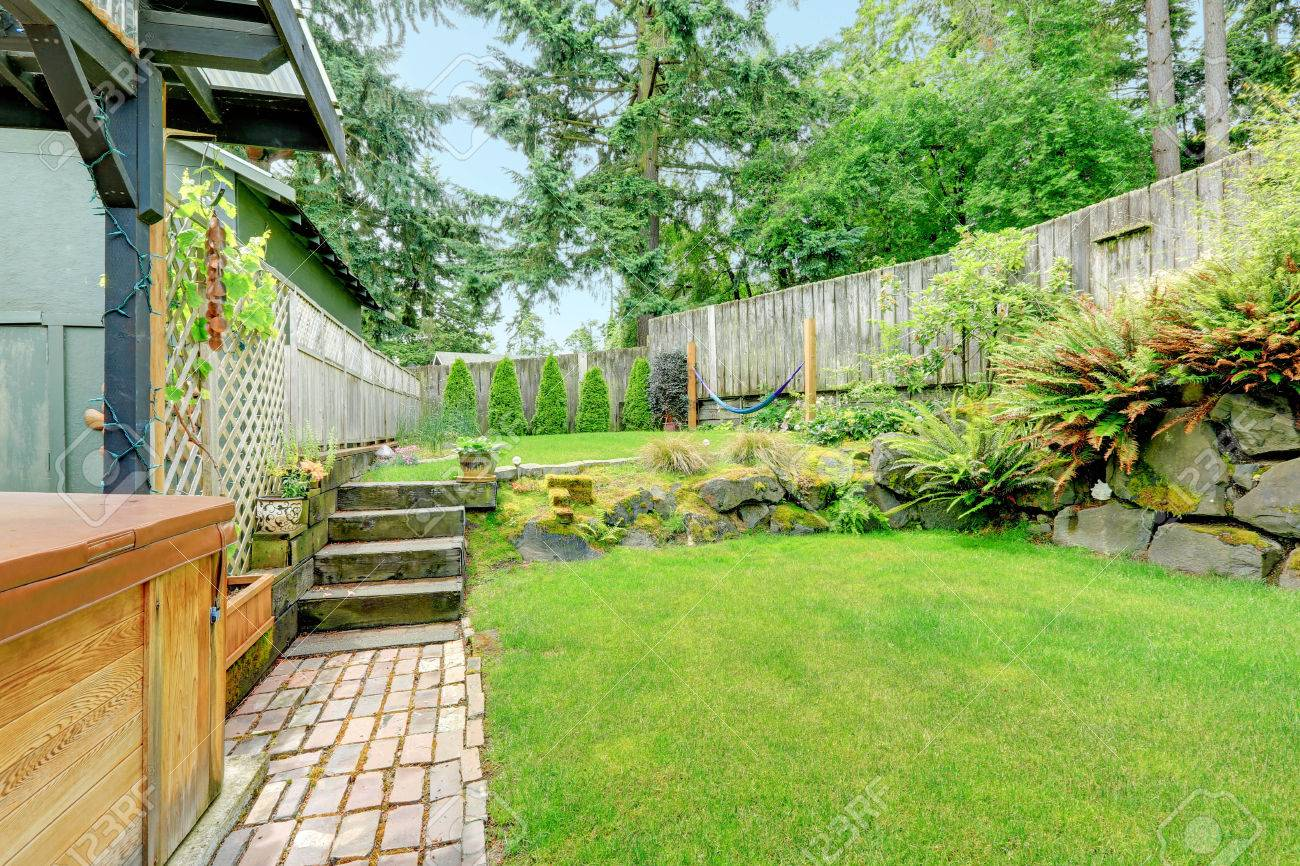 backyard landscape design with stone trim brick tile floor