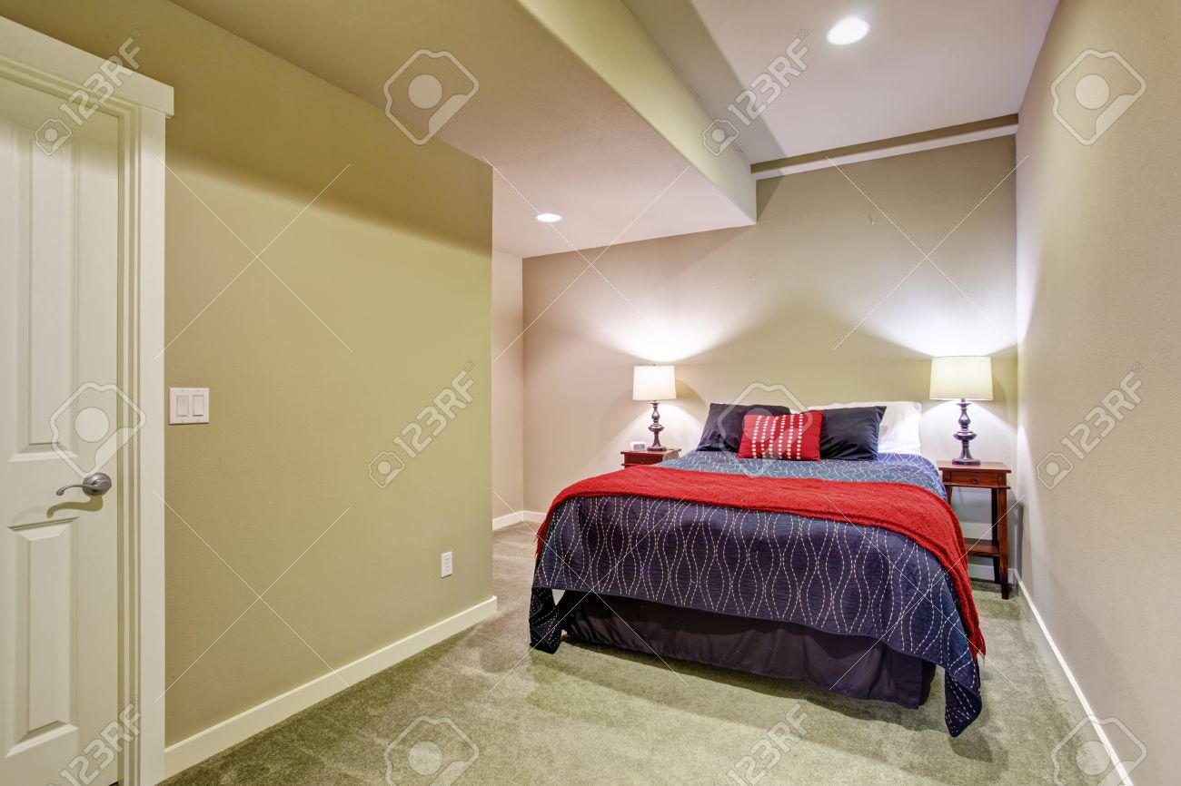 Marvelous Basement Guest Bedroom Without Windows With Blue And Red Bedding. Stock  Photo   41138277