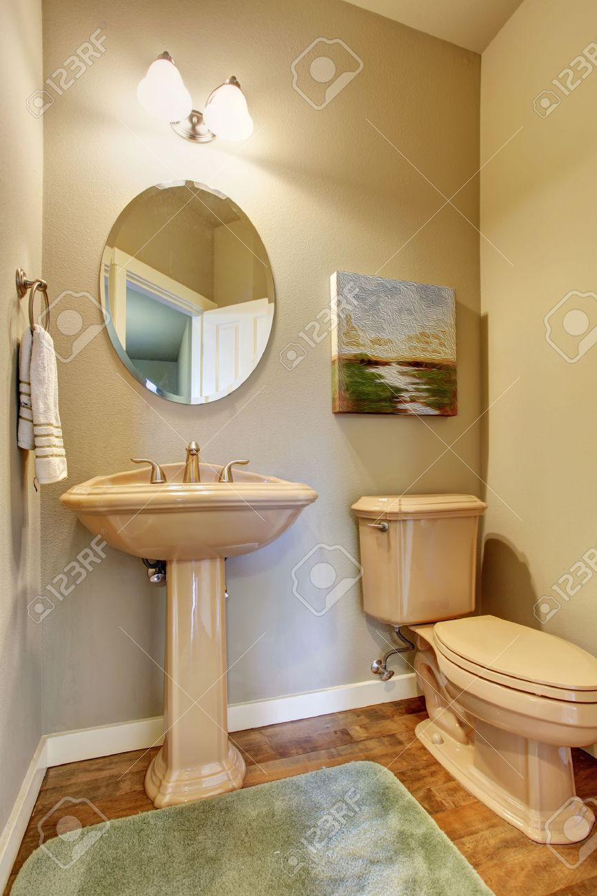 Small Half Bathroom With Toilet Sink And Wooden Floor. Stock Photo ...