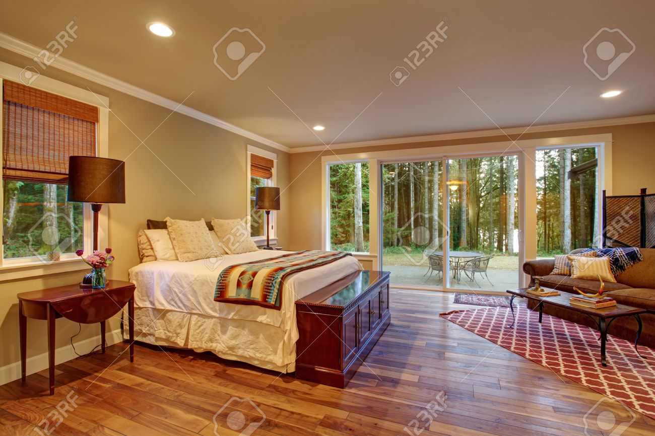 Large Master Bedroom With Hardwood Floor And Sliding Glass Door Stock Photo Picture And Royalty Free Image Image 41629797