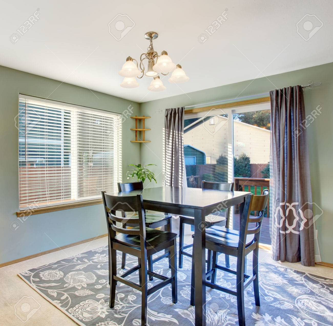 Well Put Together Dinning Room With Sliding Glass Door Window