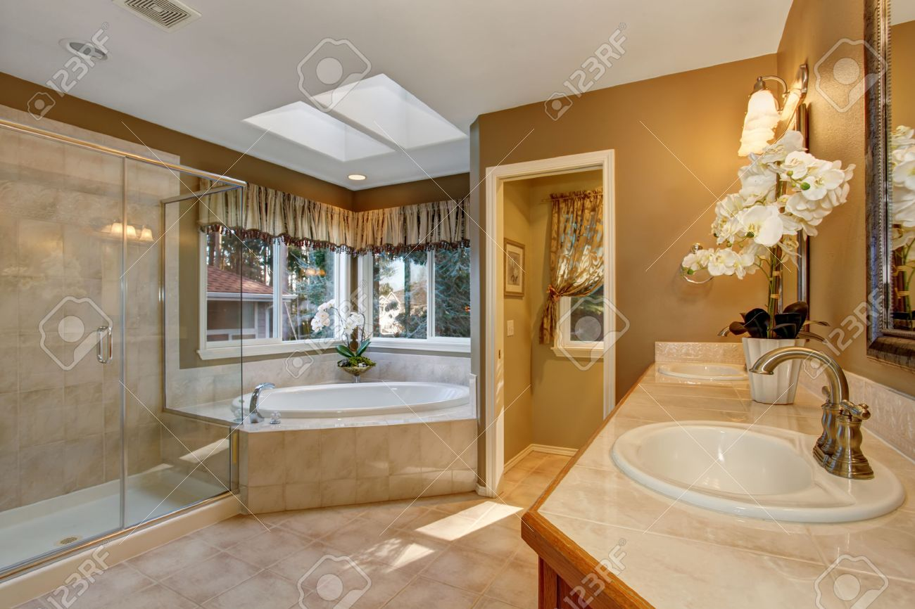 Large elegant master bathroom with shower  and big bath tub  Stock Photo    43014385. Large Elegant Master Bathroom With Shower  And Big Bath Tub  Stock