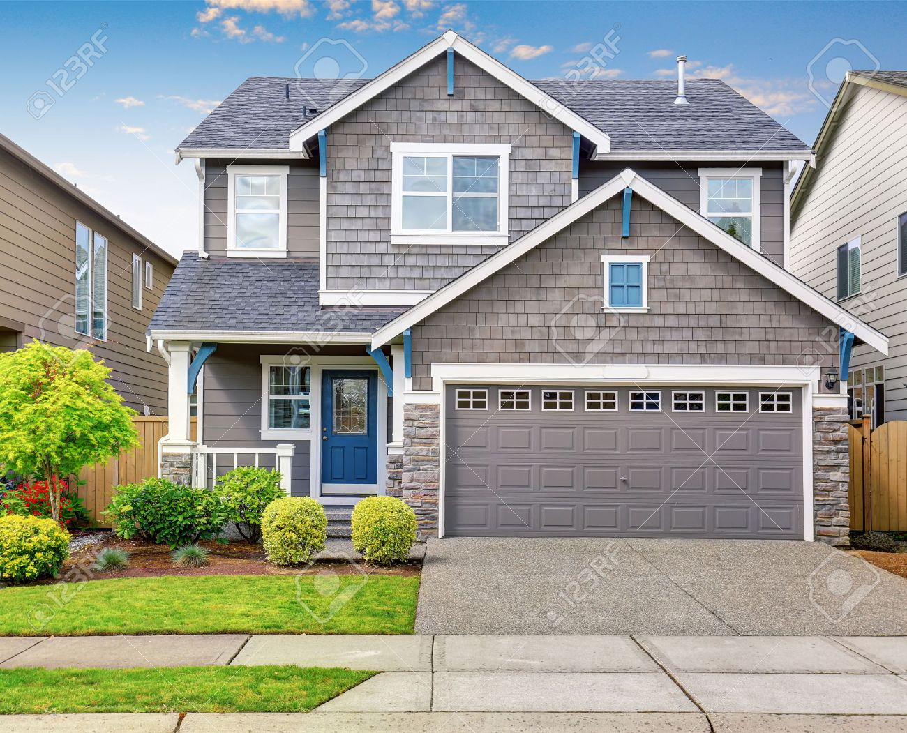 modern house with gray exterior and white trim stock photo